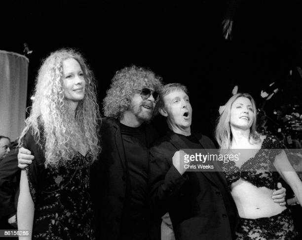 Jeff Lynne and guest with Sir Paul McCartney and wife Heather Mills arrive at the Vanity Fair Oscar Party March 24 2002 in West Hollywood CA