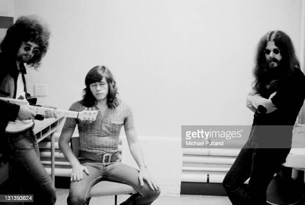 LR Jeff Lynne Bev Bevan and Roy Wood then members of both The Move and Electric Light Orchestra pose backstage in a dressing room while appearing as...
