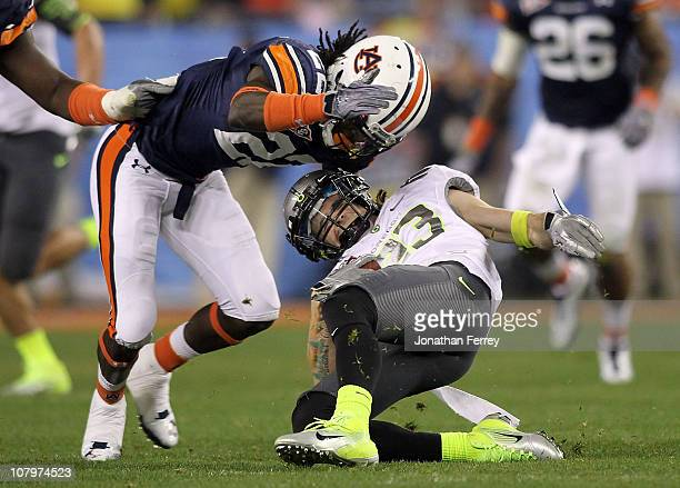 Jeff Maehl of the Oregon Ducks is tackled for a loss by T'Sharvan Bell of the Auburn Tigers in the third quarter during the Tostitos BCS National...