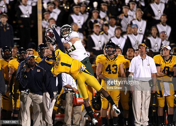 Jeff Maehl of the Oregon Ducks jumps over Steve Williams of the California Golden Bears to catch the ball in front of the Cal sideline at California...