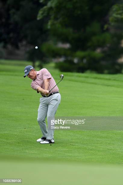 Jeff Maggert chips to the first green during the first round of the Ally Challenge presented by McLaren at Warwick Hills Golf Country Club on...