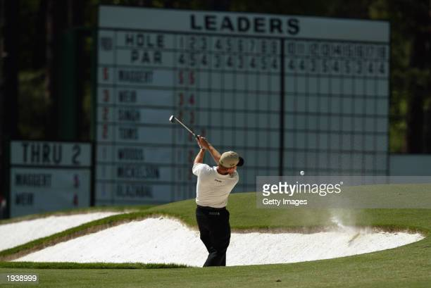 Jeff Maggert of the USA plays out of the third hole bunker as the ball comes back and hits him during the final round of the 2003 Masters Tournament...