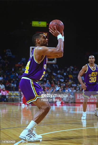 Jeff Malone of the Utah Jazz shoots against the Washington Bullets during an NBA basketball game circa 1991 at the Capital Centre in Landover...