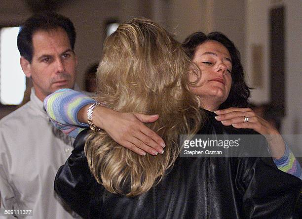 Jeff Markowitz looks on as his wife Susan is embraced by their daughter Leah Goyanes outside the Santa Barbara County Superior Court where Ryan Hoyt...