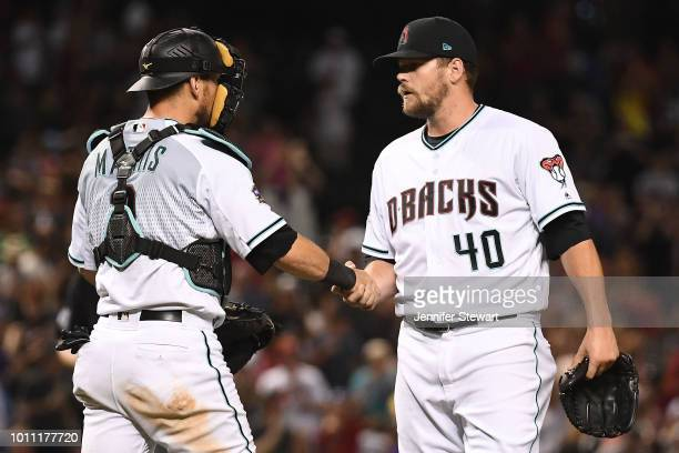 Jeff Mathis and Andrew Chafin of the Arizona Diamondbacks celebrate after closing out the MLB game against the San Francisco Giants at Chase Field on...