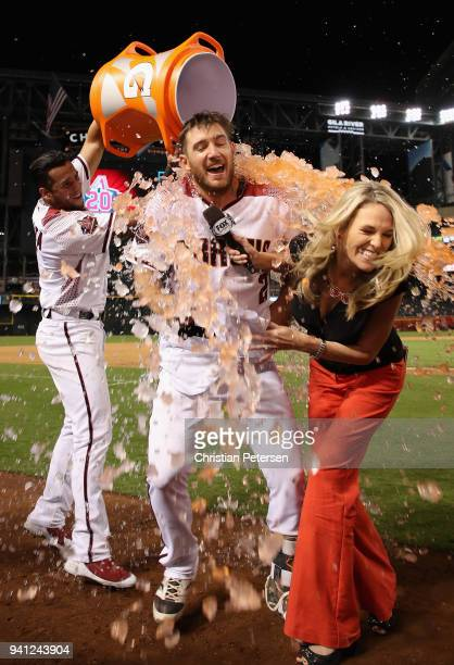 Jeff Mathis of the Arizona Diamondbacks and fox sports reporter Kate Longworth are dunked with gatorade by David Peralta after a walkoff RBI single...