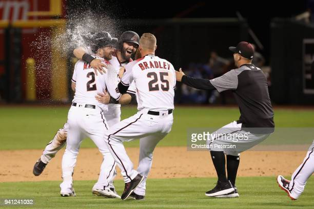 Jeff Mathis of the Arizona Diamondbacks is congratulated by Alex Avila and Archie Bradley after a walkoff single to defeat the Los Angeles Dodgers 87...