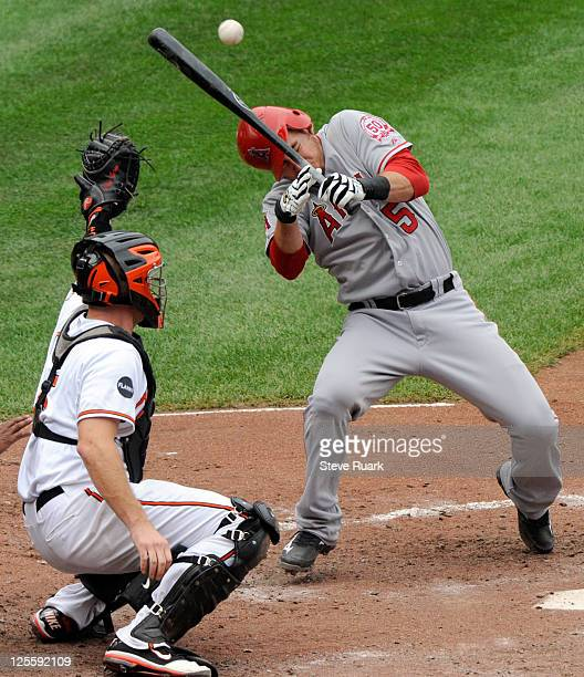 Jeff Mathis of the Los Angeles Angels of Anaheim is hit by a pitch delivered by pitcher Brad Bergesen not pictured #35 of the Baltimore Orioles as...
