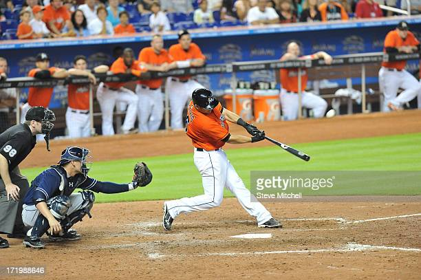 Jeff Mathis of the Miami Marlins hits a grand slam during the ninth inning against the San Diego Padres at Marlins Park on June 30 2013 in Miami...