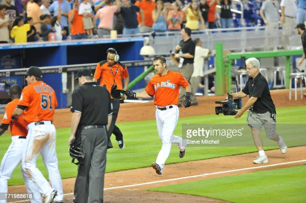 Jeff Mathis of the Miami Marlins is greeted at home plate after hitting a grand slam during the ninth inning against the San Diego Padres at Marlins...