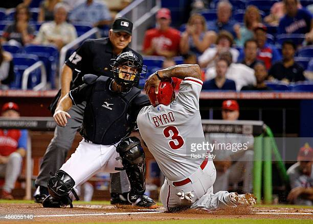 Jeff Mathis of the Miami Marlins tags out Marlon Byrd of the Philadelphia Phillies during the second inning of the game at Marlins Park on September...