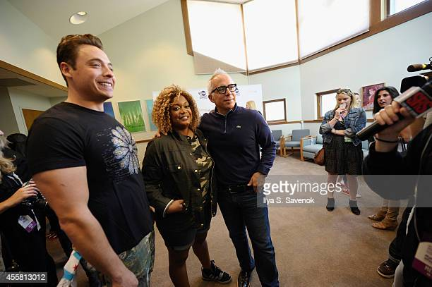 Jeff Mauro Sunny Anderson and Geoffrey Zakarian attend Food Network In Concert on September 20 2014 in Chicago Illinois
