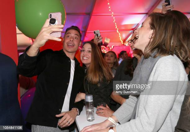 Jeff Mauro takes a selfie with guests during Food Network's 25th Birthday Party Celebration at the 11th annual New York City Wine Food Festival at...