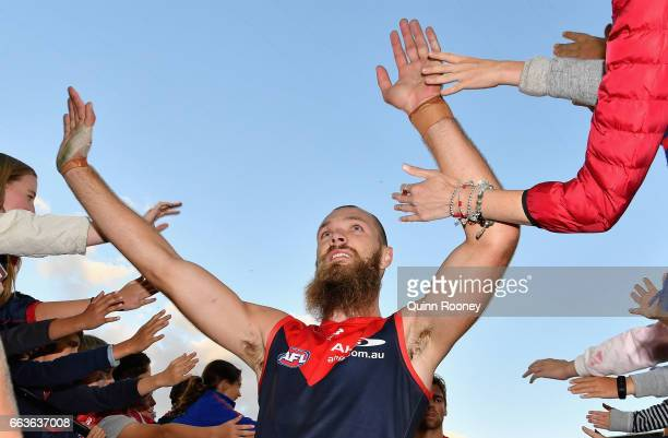 Jeff Max Gawn of the Demons high five fans after winning the round two AFL match between the Melbourne Demons and the Carlton Blues at Melbourne...