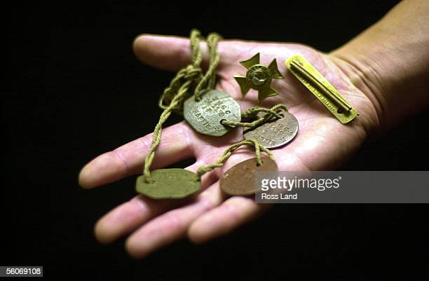 Jeff McHaffie holds his grandfathers dog tags and pins after taking them to gallipoli for the 85th ANZAC commemoration ceremonies