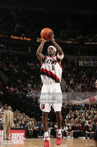 Jeff McInnis of the Portland Trail Blazers takes a jump shot in a game against the New Jersey Nets on November 28 2003 at the Rose Garden Arena in...