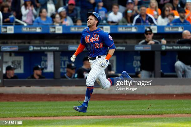 Jeff McNeil of the New York Mets heads home to score a run during the fourth inning against the Miami Marlins at Citi Field on September 30 2018 in...