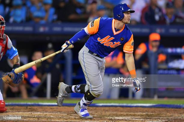 Jeff McNeil of the New York Mets hits a single in the ninth inning against the Philadelphia Phillies during the MLB Little League Classic BBT...