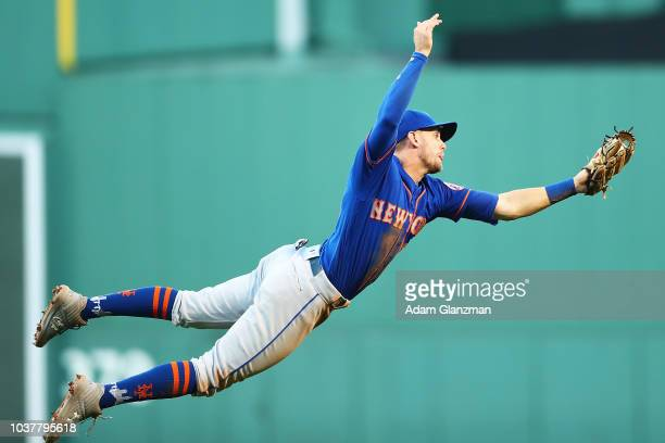 Jeff McNeil of the New York Mets makes a diving catch in the sixth inning of a game against the Boston Red Sox at Fenway Park on September 15 2018 in...