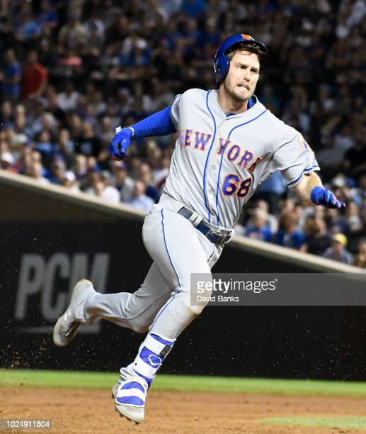 Jeff McNeil of the New York Mets runs to third base with a triple against the Chicago Cubs during the seventh inning on August 28 2018 at Wrigley...