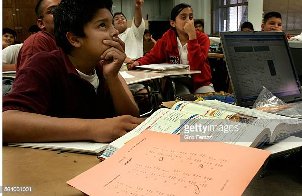 Jeff Melendez studies an overhead projection during his seventh grade math class on scientific notation at Virgil Middle School in Koreatown Tuesday...