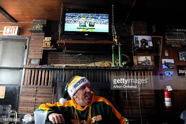 Jeff Muetz watches the pregame show during a Super Bowl party at Rocky Flats near Boulder on Sunday February 6 2011 The bar has been showing Packers...
