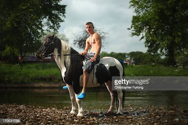 Jeff Nesham aged 16 poses as he rides Trigger in the River Eden during the Appleby Horse Fair on June 6 2013 in Appleby England The Appleby Horse...
