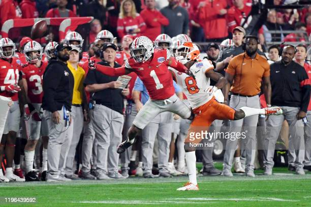 Jeff Okudah of the Ohio State Buckeyes defends a pass to Justyn Ross of the Clemson Tigers in the second half during the College Football Playoff...