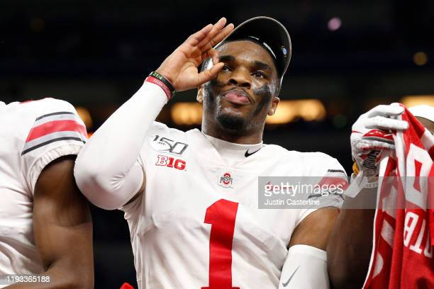 Jeff Okudah of the Ohio State Buckeyes on the post game stage after winning the Big Ten Championship game over the Wisconsin Badgers at Lucas Oil...