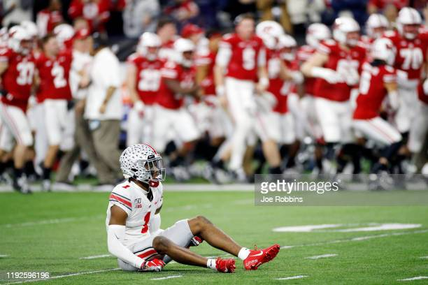 Jeff Okudah of the Ohio State Buckeyes reacts after a 44yard touchdown run by Jonathan Taylor of the Wisconsin Badgers in the first quarter of the...