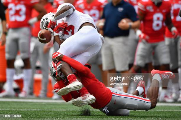 Jeff Okudah of the Ohio State Buckeyes tackles Larry McCammon III of the Florida Atlantic Owls causing a fumble in the first quarter at Ohio Stadium...