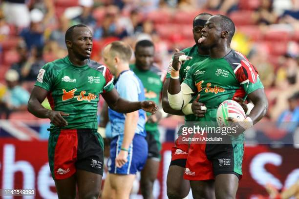 Jeff Oluoch of Kenya celebrates scoring a try with his team mates during the 13th place semi final between Japan and Kenya on day two of the HSBC...