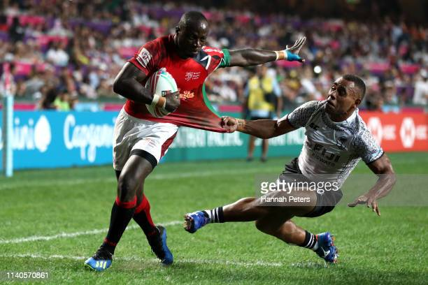 Jeff Oluoch of Kenya dives over to score a try during the Pool C match between Kenya and Fiji on day one on day one of the Cathay Pacific/HSBC Hong...