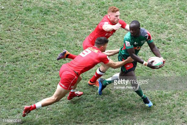 Jeff Oluoch of Kenya looks to offload the ball against Canada on day three of the Cathay Pacific/HSBC Hong Kong Sevens at the Hong Kong Stadium on...