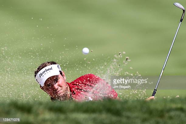 Jeff Overton hits a shot out of the bunker on the 14th hole during the second round of the Deutsche Bank Championship at TPC Boston on September 3...