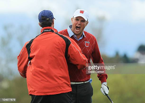 Jeff Overton of the USA celebrates after holing out for an eagle on the 8th hole during the Fourball Foursome Matches during the 2010 Ryder Cup at...
