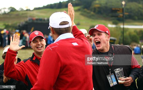 Jeff Overton of the USA celebrates with golf fans from Indiana after holing out for an eagle on the 8th hole during the Fourball Foursome Matches...
