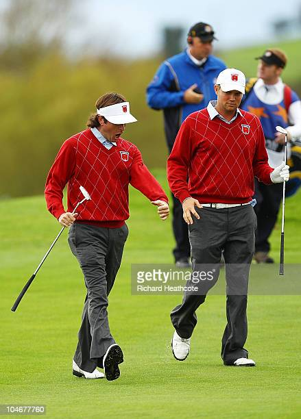 Jeff Overton of the USA celebrates with team mate Bubba Watson after holing out for an eagle on the 8th hole during the Fourball Foursome Matches...