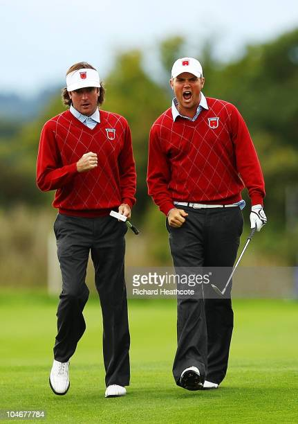 Jeff Overton of the USA celebrates with team mate Bubba Watson after holing out for an eagle on the 8th hole during the Fourball & Foursome Matches...