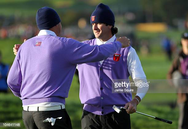 Jeff Overton of the USA celebrates with team mate Bubba Watson on the 11th green during the rescheduled Morning Fourball Matches during the 2010...