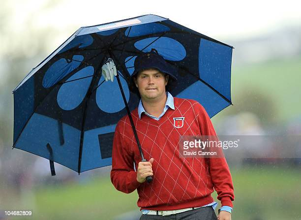 Jeff Overton of the USA waits under an umbrella during the Fourball Foursome Matches during the 2010 Ryder Cup at the Celtic Manor Resort on October...