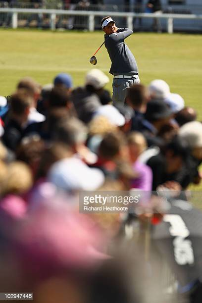 Jeff Overton of the USA watches his tee shot on the second hole during the third round of the 139th Open Championship on the Old Course St Andrews on...