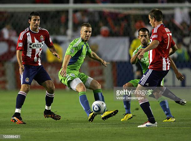 Jeff Parke of Seattle Sounders FC defends the pass play by Justin Braun of Chivas USA as Alan Gordon of Chivas USA and Patrick Ianni of Seattle...