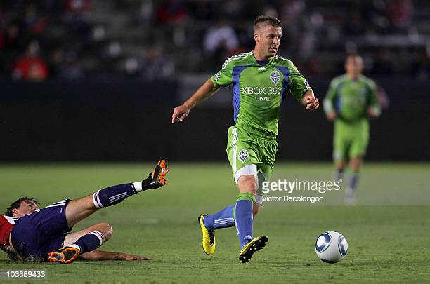 Jeff Parke of Seattle Sounders FC paces the ball on the attack after avoiding a tackle by Alan Gordon of Chivas USA in the second half of their MLS...