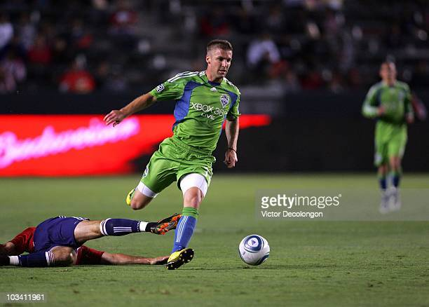 Jeff Parke of Seattle Sounders FC paces the ball on the attack after avoiding a tackle by Alan Gordon of Chivas USA slides in the second half of...