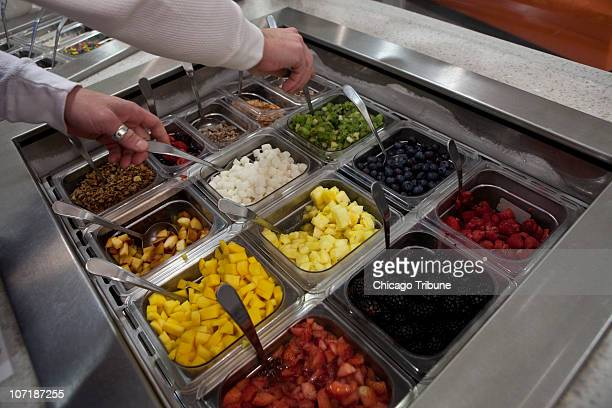 Jeff Paulus manager of Starfruit Cafe prepares fresh fruits served with kefir a yogurt drink that is a staple in Eastern Europe at their new location...