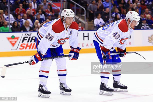 Jeff Petry and Arturri Lehkonen of the Montreal Canadiens get set for a faceoff during an NHL preseason game against the Toronto Maple Leafs at Air...