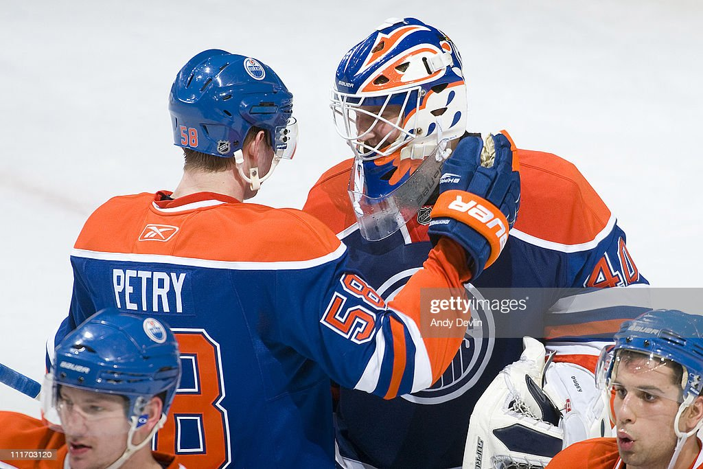 Jeff Petry #58 congratulates Devan Dubnyk #40 of the Edmonton Oilers after a 2-0 shut-out win over the Vancouver Canucks at Rexall Place on April 5, 2011 in Edmonton, Alberta, Canada.