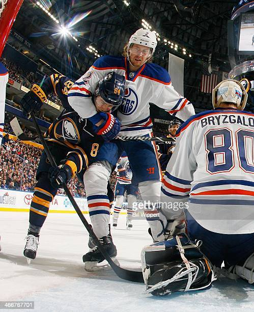 Jeff Petry of the Edmonton Oilers grabs hold of Philip Varone of the Buffalo Sabres in front of Oilers goaltender Ilya Bryzgalov on February 3, 2014...