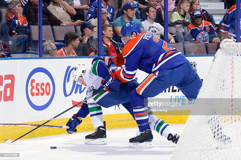 Jeff Petry #2 of the Edmonton Oilers shoves Hunter Shinkaruk #48 of the Vancouver Canucks during a preseason NHL game at Rexall Place on September 21, 2013 in Edmonton, Alberta, Canada.